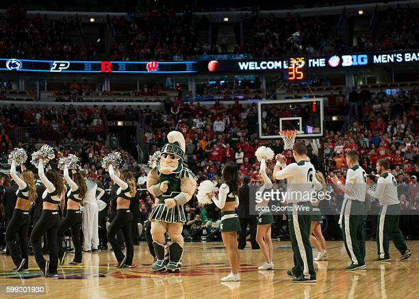 Michigan State mascot and cheerleaders during the Big Ten Men's Basketball Tournament Championship game between the Wisconsin Badgers and the...