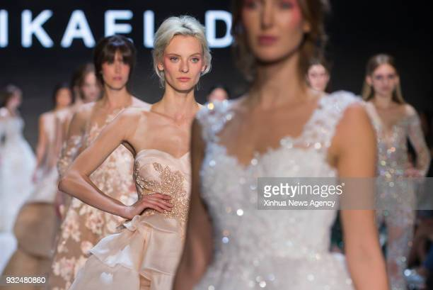 Models present creations by Mikael D during the Toronto Women's Fashion Week 2018 Fall/Winter in Toronto Canada March 14 2018