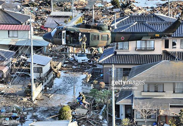 March 15,2011/Noboru Hashimoto/Tokyo/Japan Mega eartquake disaster in Northern Japan.The self-defense force helicopter lifts a victim in Watari-town...