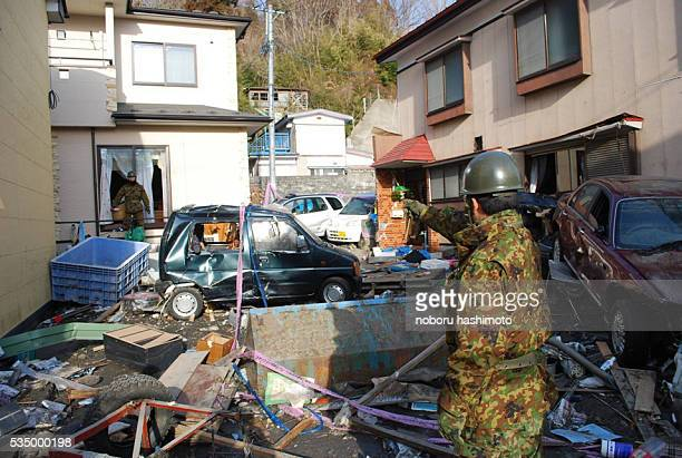 March 15,2011/Noboru Hashimoto/Tokyo/Japan Mega eartquake disaster in Northern Japan.The self-defense force soldiers search victimsl in Iwanuma-city...