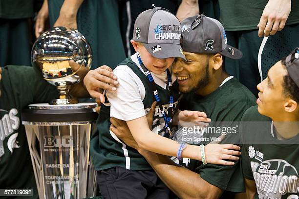 Michigan State Spartans center Adreian Payne celebrates with Mateen Izzo son of head coach Tom Izzo after the Big Ten Men's Basketball Tournament...
