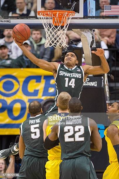 Michigan State Spartans guard Gary Harris goes in for a reverse dunk during the Big Ten Men's Basketball Tournament Championship Game game between...