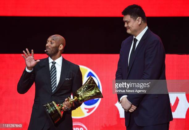 SHENZHEN March 16 2019 Kobe Bryant L World Cup Ambassador and Yao Ming president of the Chinese Basketball Association react during the draw ceremony...