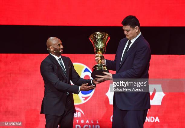 SHENZHEN March 16 2019 Kobe Bryant L World Cup Ambassador hands over the World Cup Trophy to Yao Ming president of the Chinese Basketball Association...