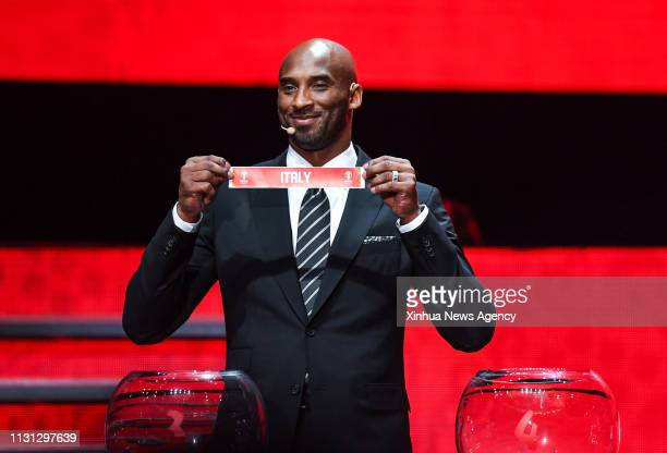 SHENZHEN March 16 2019 Kobe Bryant World Cup Ambassador shows a ticket of Italy during the draw ceremony of 2019 FIBA Basketball World Cup in...