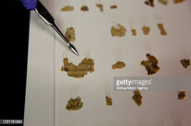 March 16, 2021 -- Fragments of the new discovered Dead Sea Scroll are seen in a lab in the Israel Museum in Jerusalem on March 16, 2021. Israeli...