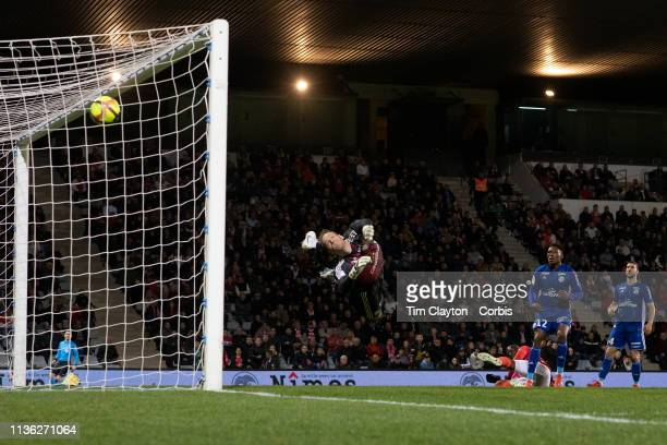 March 16: Goalkeeper Matz Sels of Strasbourg dives full length but can't stop a shot form Herve Libohy of Nimes for his sides first goal in their...