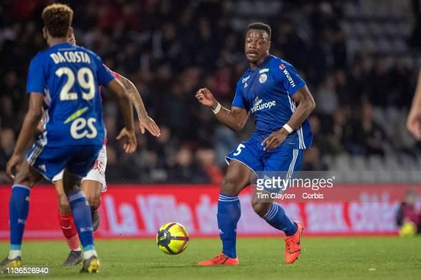 Lamine Kone of Strasbourg passes to team mate Nuno Da Costa of Strasbourg during the Nimes V Strasbourg French Ligue 1 regular season match at Stade...