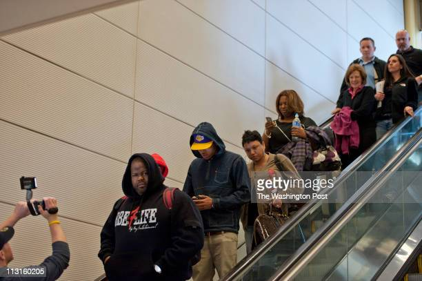 Paparazzi get video footage and photographs RampB singer Chris Brown when he arrived at the Reagan National Airport in Arlington Virginia on March 16...