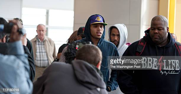 RampB singer Chris Brown arrives at Reagan National Airport in Arlington Virginia on March 16 2011 Colin Drummond a longtime freelance photographer...