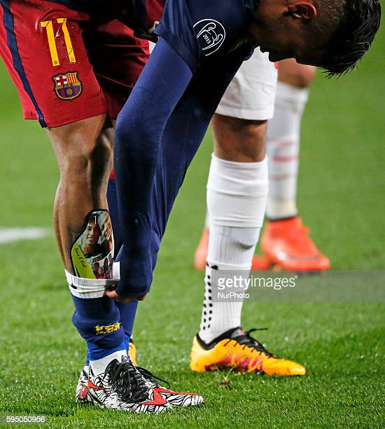 the shinguard of Neymar Jr with the image of him and his father during the match between FC Barcelona and Arsenal FC corresponding to the second legh...