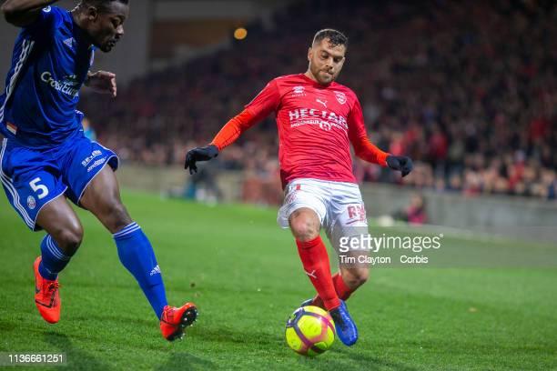 Teji Savanier of Nimes defended Lamine Kone of Strasbourg during the Nimes V Strasbourg French Ligue 1 regular season match at Stade des Costieres on...