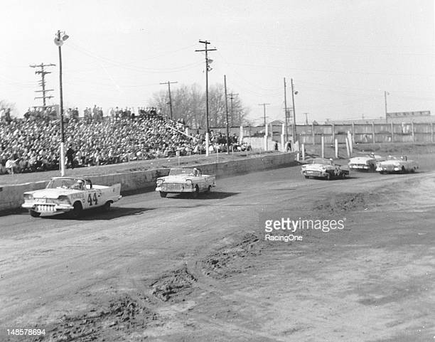 "Al Tasnady in a Plymouth leads the Ford of Curtis Turner and the Chevrolet of Lewis ""Possum"" Jones during the NASCAR Convertible Division race at..."