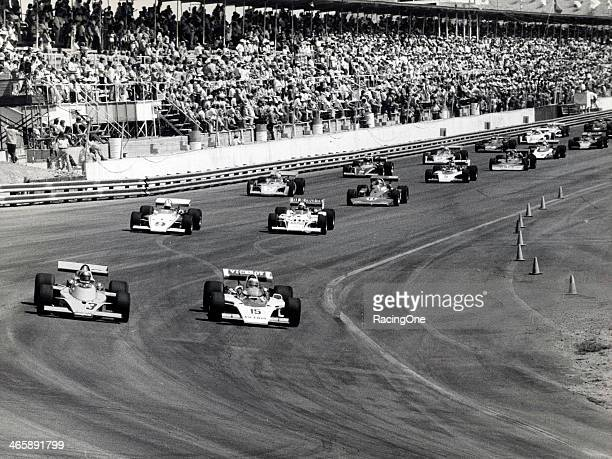 The field gets set for the start of the Phoenix 150 USAC Indy Car race at Phoenix International Raceway Al Unser starts from the pole flanked by...