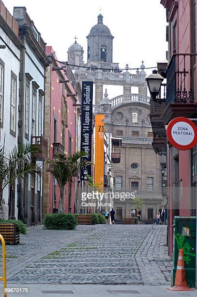 March 17, 2007. Las Palmas de Gran Canaria. Canary Islands. View of a pedestrian street in the historic centre of Vegueta and, at the bottom, Saint...