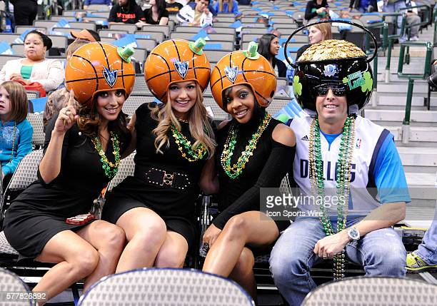 Fans dress up for St Patricks Day during an NBA game between the Boston Celtics and the Dallas Mavericks at the American Airlines Center in Dallas TX...