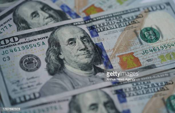C March 17 2020 Photo taken on March 17 2020 shows US dollar banknotes in Washington DC the United States The Trump administration on Tuesday...