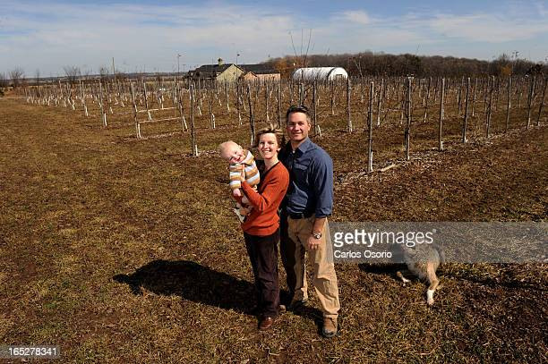 March 18 2010 Thomas Wilson his wife Dr Nicole Judge and their 7monthold son Kiernan Wilson pose for a photo at the Cidery Also in the photo is their...