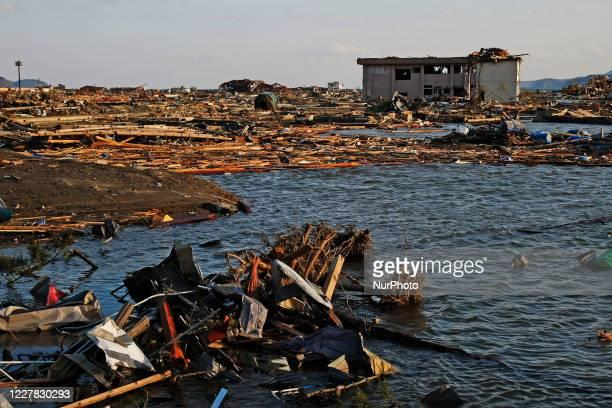 March 18, 2011-Rikuzen Takata, Japan-View of Flooding stadium at Debris and Mud covered on Tsunami hit Destroyed city in Rikuzentakata on March 18...