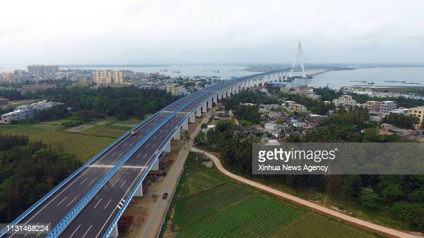 HAIKOU March 18 2019 Aerial photo taken on March 18 2019 shows the Haiwen Bridge south China's Hainan Province The crosssea bridge which was built...