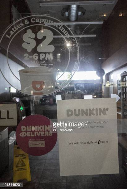 March 18 MANDATORY CREDIT Bill Tompkins/Getty Images Dunkin Donuts store closing due to the coronavirus COVID-19 pandemic on March 18, 2020 in New...