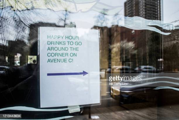 March 18 MANDATORY CREDIT Bill Tompkins/Getty Images Sign that reads HAPPY HOUR DRINKS TO GO to be picked up at a side take out location due to the...