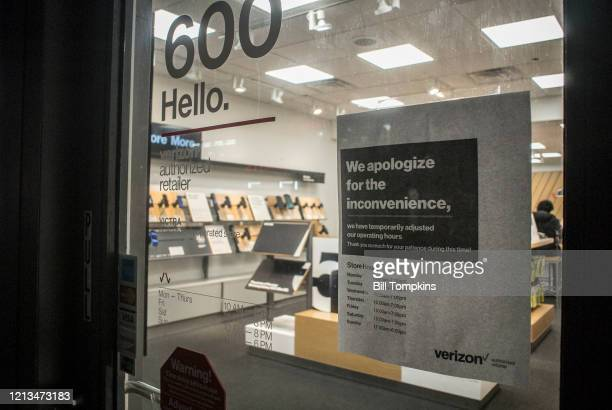 NEW YORK NY March 18 MANDATORY CREDIT Bill Tompkins/Getty Images Verizon store hours of operation change notice due to the coronavirus COVID19...