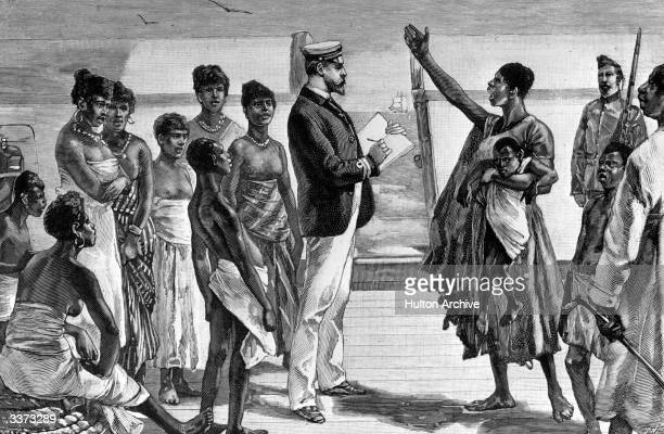 Rescued slaves being questioned on board a British ship of war in East Africa