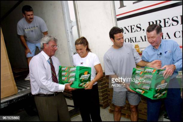 March 19, 2001. Ericsson Open Chairman Butch Buchholz takes a case of Gator Aide from Jennifer Capriati while Spanish tennis ace Alex Corretja takes...