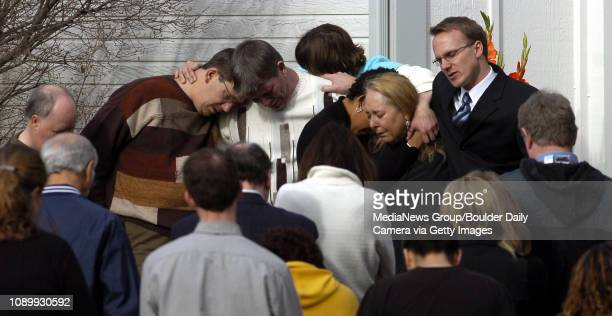 March 19 2007 / Westminster / Lynn Segal gives Carolyn Bninski right a hug after Allen Salazar with Congressman Mark Udall's office asked about 10...