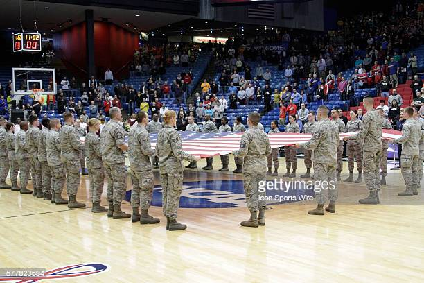 Color Guard with the Stars & Stripes during the National Anthem before during the first round of the Cal Poly Mustangs game versus the Texas Southern...