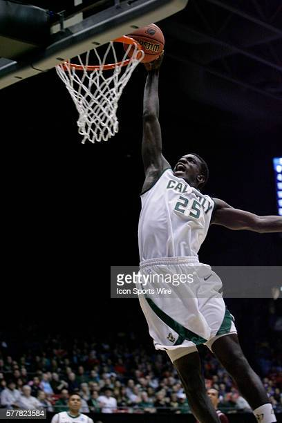 Joel Awich of the Cal Poly Mustangs with a slam dunk during the first round of the Cal Poly Mustangs game versus the Texas Southern Tigers in the...