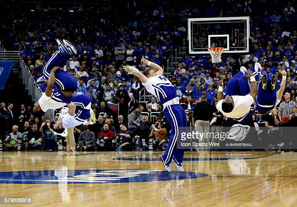 Kentucky Wildcats male cheerleaders perform during a second-round NCAA Tournament game between the Hampton University Pirates and the University of...