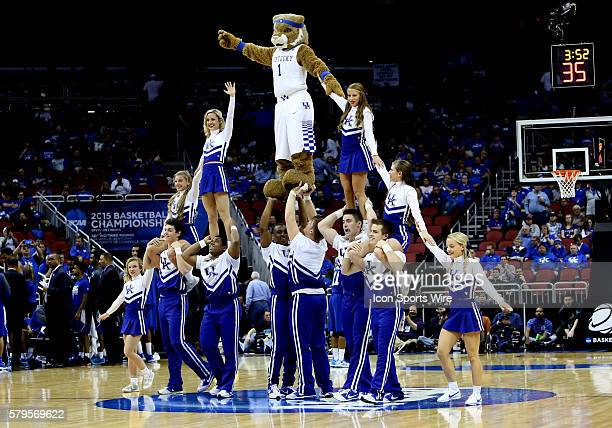 The Kentucky Wildcats mascot and cheerleaders perform a pyramid during a secondround NCAA Tournament game between the Hampton University Pirates and...