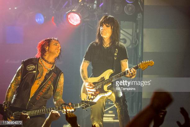 Nikki Sixx and Mick Mars of Motley Crue perform on July 151999 in New York City