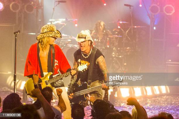 Vince Neil and Nikki Sixx of Motley Crue perform on July 151999 in New York City