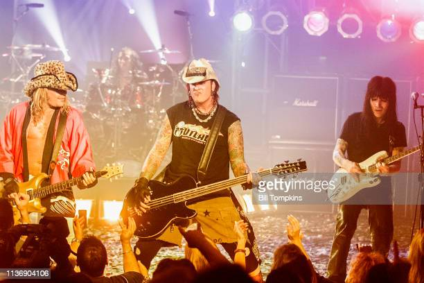 Vince Neil Nikki Sixx and Mick Mars of Motley Crue perform on July 151999 in New York City