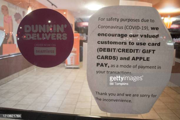 March 19 MANDATORY CREDIT Bill Tompkins/Getty Images Dunkin Donuts request for specific process of payment due to the coronavirus COVID19 pandemic on...