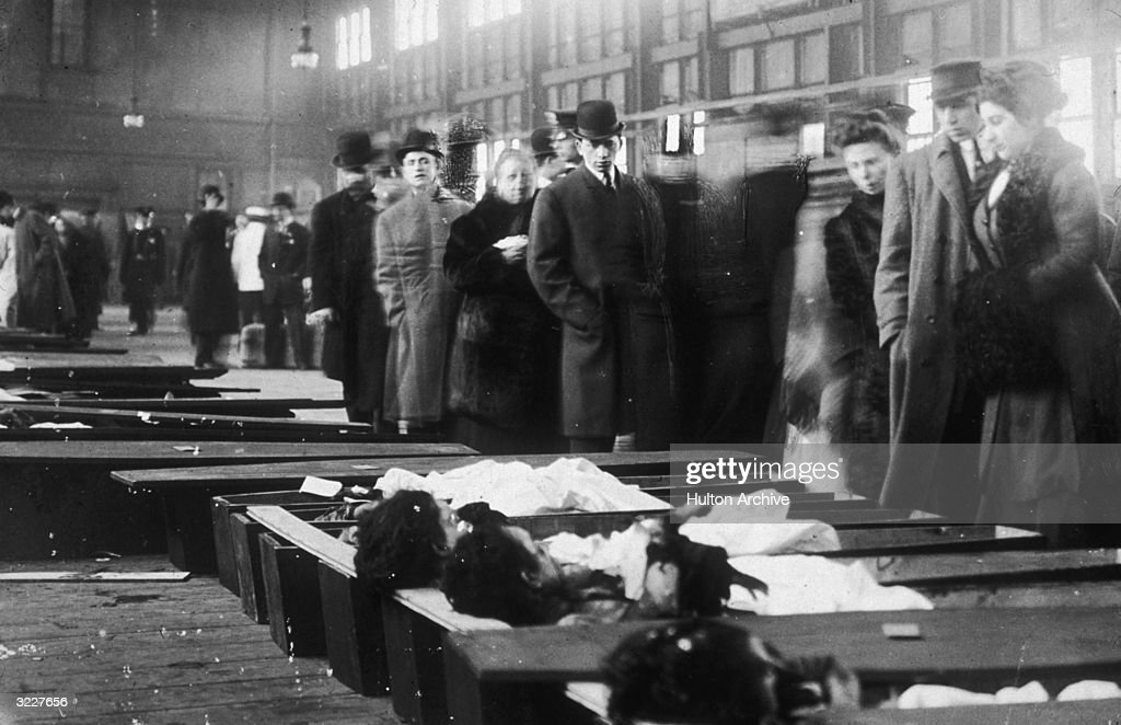 People line up to identify the bodies of victims after a fire at the Triangle Shirtwaist Company in New York, in which 146 workers were killed on 25th March 1911. The disaster drew attention to inadequate fire regulations and poor working conditions in the city's sweatshops.