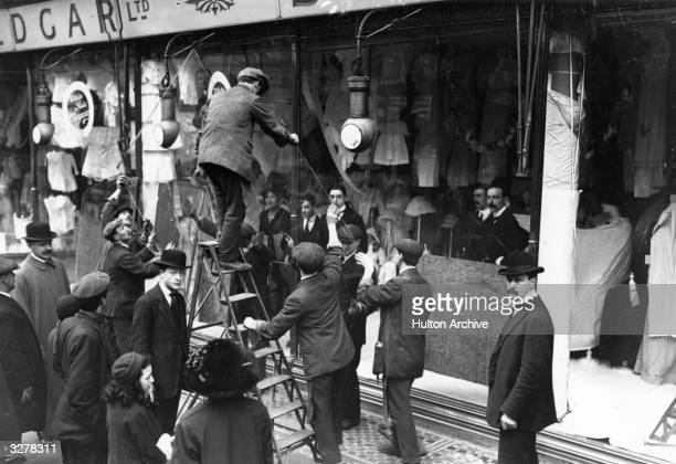 A clearing up operation after windowsmashing by suffragettes