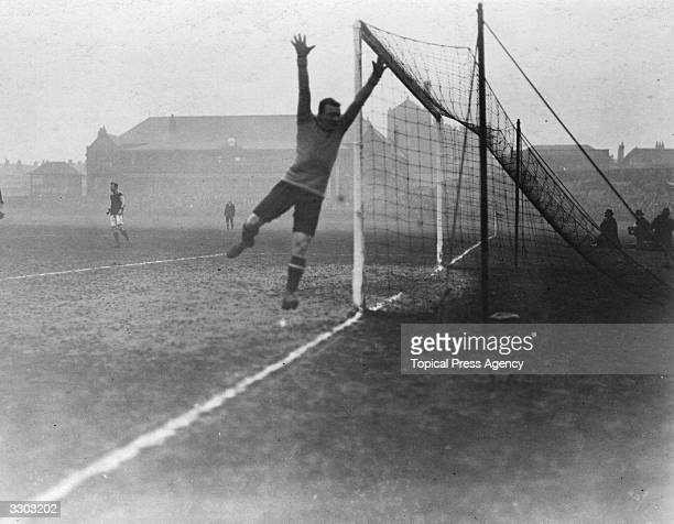 Sunderland FC's goalkeeper sees the ball safely out of danger during a semifinal FA Cup Tie against Burnley FC at Sheffield