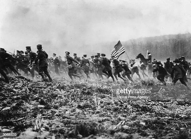 American troops preparing for WW I on a mock battlefield.