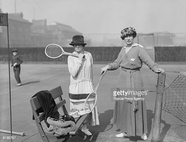 Mrs Mathieson and Lady Headfort on a tennis court at Queen's Club.