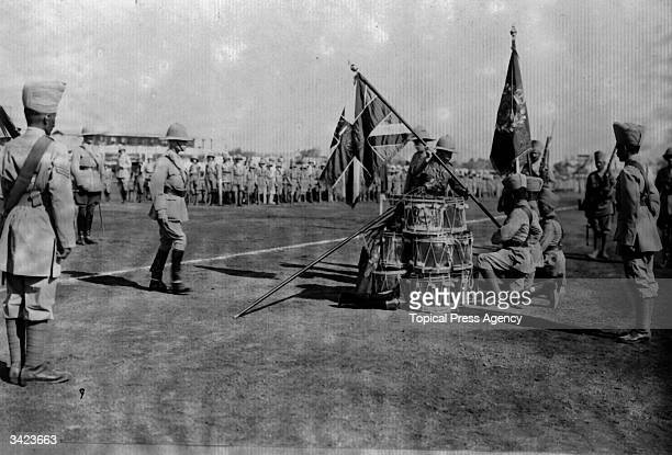 The Duke of Connaught presenting colours at Poona to the 110th Madras
