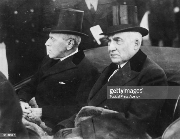 Warren Gamaliel Harding , the 29th President of the United States of America, riding in a carriage with the former President Woodrow Wilson during...