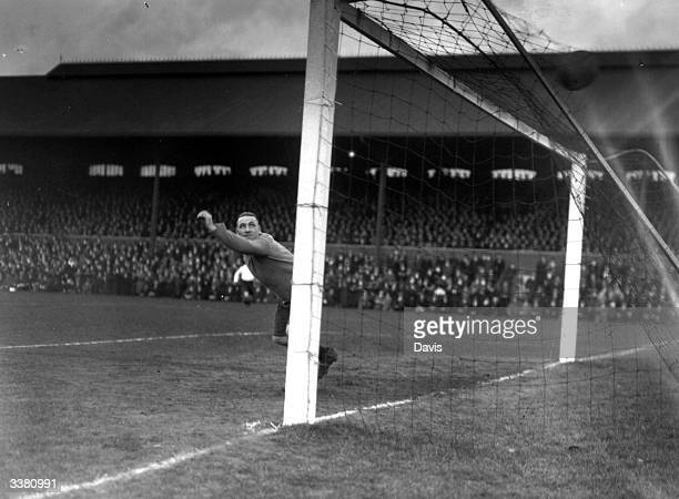 Fulham's first goal is scored in a 6th round FA Cup match against Manchester United at Craven Cottage London