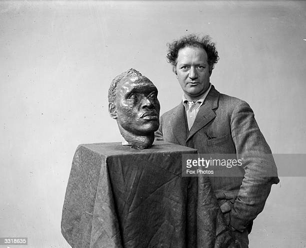 USborn British sculptor Jacob Epstein with his bust of singer Paul Robeson