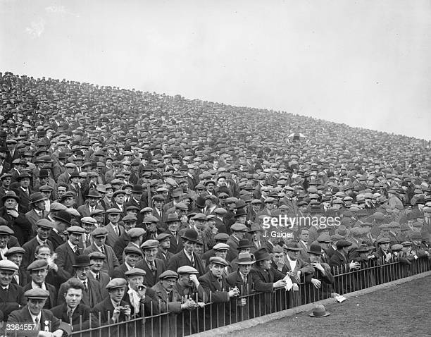 A crowd of spectators at the FA Cup semifinal replay between Arsenal and Hull City at Birmingham which Arsenal went on to win