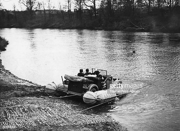 Mr Stanley Riley drives a car into the River Severn at Worcester to demonstrate a device for floating motor cars across small rivers and streams