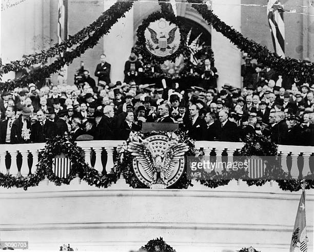 President Franklin Delano Roosevelt taking the oath of office as 32nd President of the USA. Chief Justice Charles E Hughes administers the oath as...